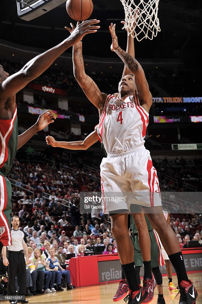 Greg Smith #4 of the Houston Rockets grabs a rebound against the Milwaukee Bucks on February 27, 2013 at the Toyota Center in Houston, Texas.