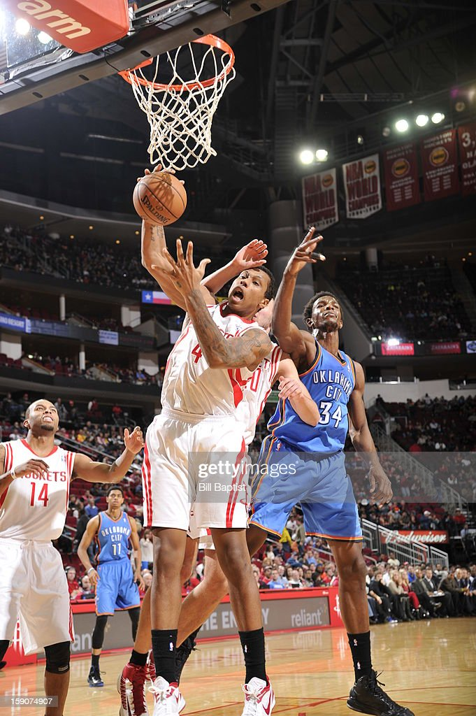 Greg Smith #4 of the Houston Rockets grabs the rebound against <a gi-track='captionPersonalityLinkClicked' href=/galleries/search?phrase=Hasheem+Thabeet&family=editorial&specificpeople=4003778 ng-click='$event.stopPropagation()'>Hasheem Thabeet</a> #34 of the Oklahoma City Thunder on December 29, 2012 at the Toyota Center in Houston, Texas.