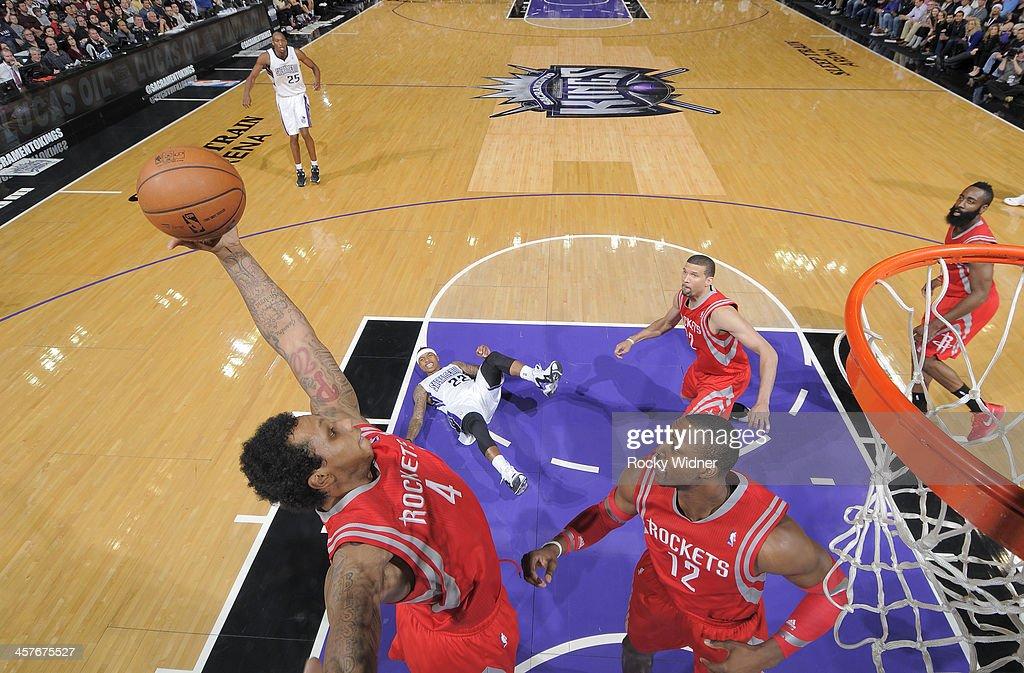 Greg Smith #4 of the Houston Rockets rebounds against the Sacramento Kings on December 15, 2013 at Sleep Train Arena in Sacramento, California.