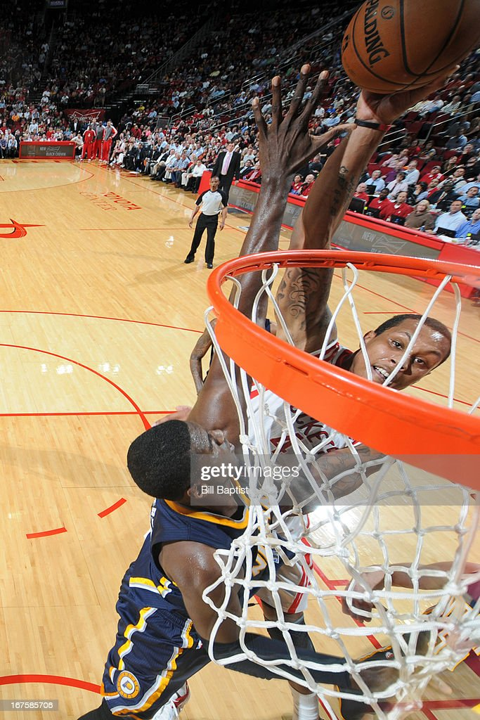 Greg Smith #4 of the Houston Rockets shoots against <a gi-track='captionPersonalityLinkClicked' href=/galleries/search?phrase=Roy+Hibbert&family=editorial&specificpeople=725128 ng-click='$event.stopPropagation()'>Roy Hibbert</a> #55 of the Indiana Pacers on March 27, 2013 at the Toyota Center in Houston, Texas.