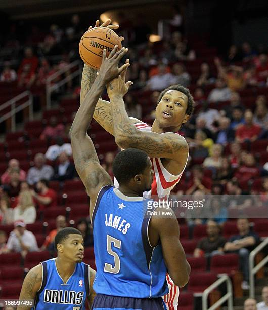 Greg Smith of the Houston Rockets shoots over Bernard James of the Dallas Mavericks in the fourth quarter at Toyota Center on November 1 2013 in...