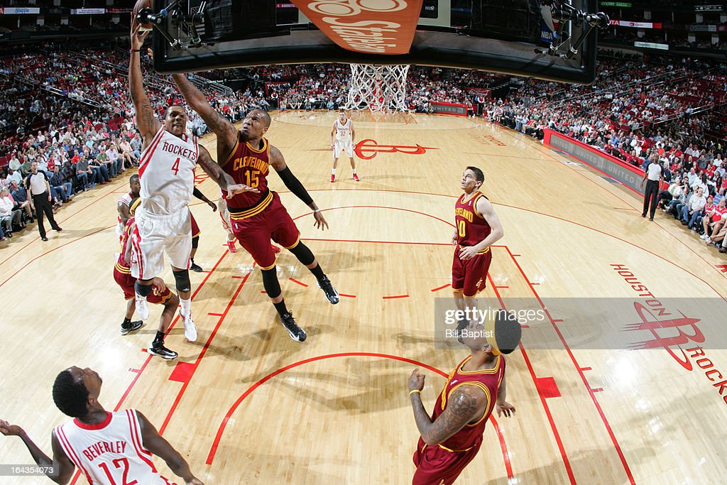 Greg Smith #4 of the Houston Rockets shoots the ball against <a gi-track='captionPersonalityLinkClicked' href=/galleries/search?phrase=Marreese+Speights&family=editorial&specificpeople=4187263 ng-click='$event.stopPropagation()'>Marreese Speights</a> #15 of the Cleveland Cavaliers on March 22, 2013 at the Toyota Center in Houston, Texas.