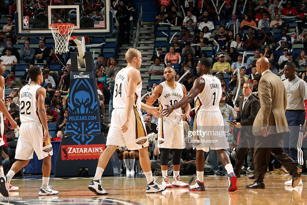 Greg Stiemsma Eric Gordon and Tyreke Evans of the New Orleans Pelicans celebrate during a game against the Denver Nuggets on March 9 2014 at the...