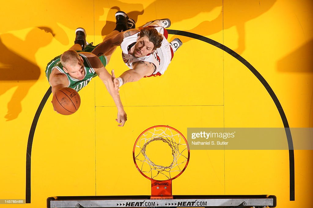 Greg Stiemsma of the Boston Celtics goes to the basket against Mike Miller of the Miami Heat in Game Five of the Eastern Conference Finals between...