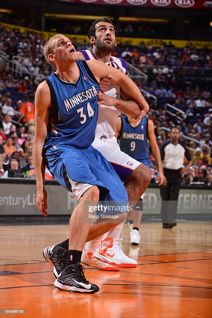 Greg Stiemsma of the Minnesota Timberwolves battles for position with Hamed Haddadi of the Phoenix Suns on March 22 2013 at US Airways Center in...