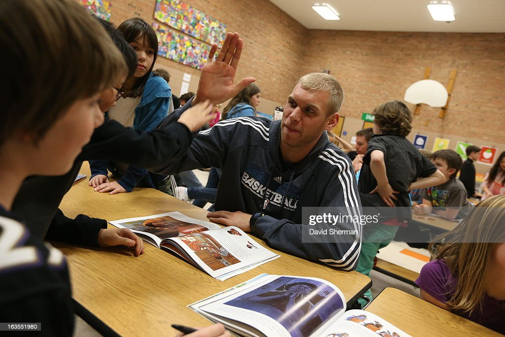 Greg Stiemsma of the Minnesota Timberwolves bigfives with a student during a Reading Timeout as part of the Minnesota Timberwolves FastBreak...