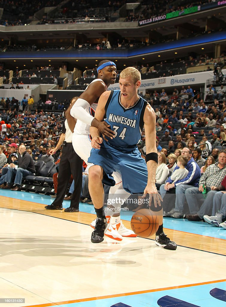 Greg Stiemsma #34 of the Minnesota Timberwolves drives against Brendan Haywood #33 of the Charlotte Bobcats at the Time Warner Cable Arena on January 26, 2013 in Charlotte, North Carolina.