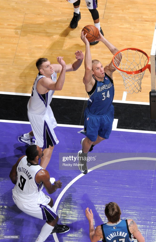 Greg Stiemsma #34 of the Minnesota Timberwolves dunks against Cole Aldrich #45 of the Sacramento Kings on March 21, 2013 at Sleep Train Arena in Sacramento, California.