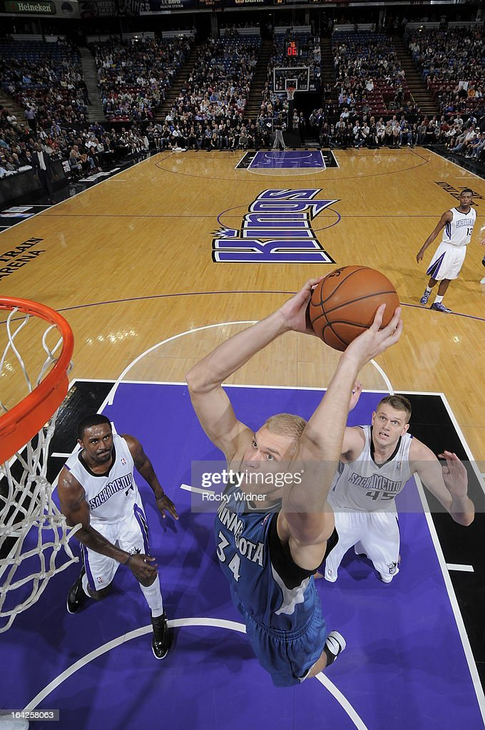 Greg Stiemsma #34 of the Minnesota Timberwolves dunks the ball against Patrick Patterson #9 and Cole Aldrich #45 of the Sacramento Kings on March 21, 2013 at Sleep Train Arena in Sacramento, California.
