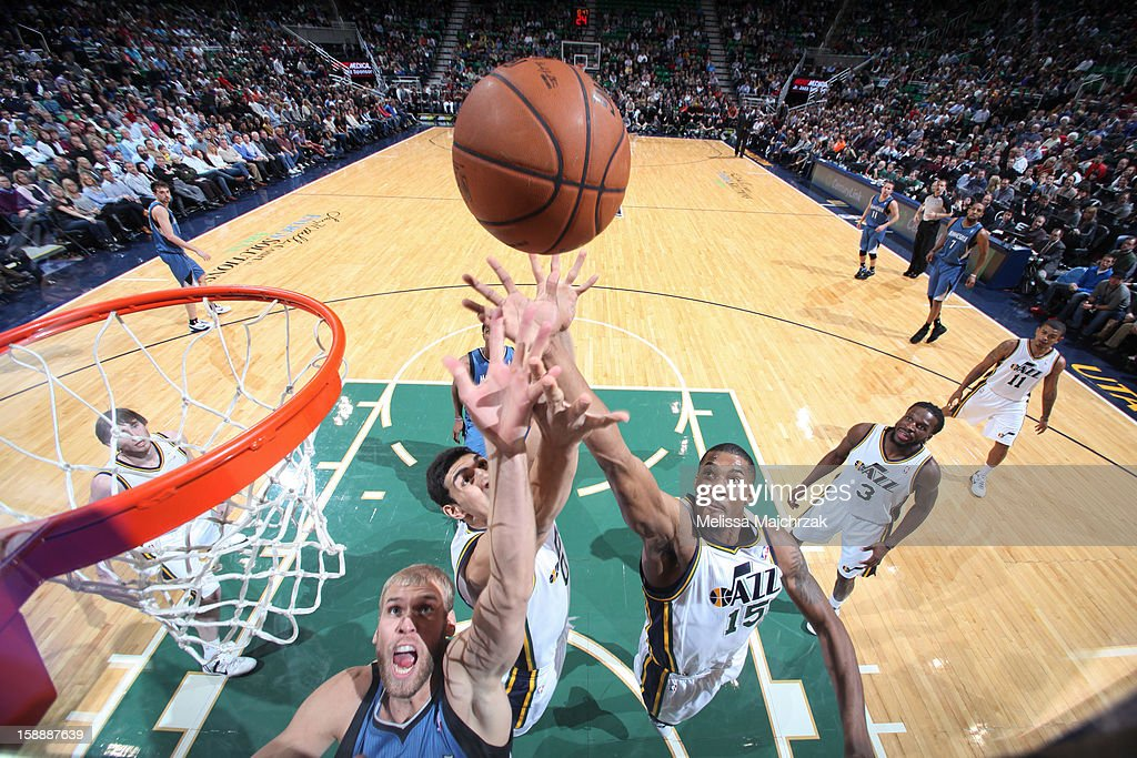 <a gi-track='captionPersonalityLinkClicked' href=/galleries/search?phrase=Greg+Stiemsma&family=editorial&specificpeople=2098297 ng-click='$event.stopPropagation()'>Greg Stiemsma</a> #34 of the Minnesota Timberwolves goes for a rebound against <a gi-track='captionPersonalityLinkClicked' href=/galleries/search?phrase=Enes+Kanter&family=editorial&specificpeople=5621416 ng-click='$event.stopPropagation()'>Enes Kanter</a> #0 and <a gi-track='captionPersonalityLinkClicked' href=/galleries/search?phrase=Derrick+Favors&family=editorial&specificpeople=5792014 ng-click='$event.stopPropagation()'>Derrick Favors</a> #15 of the Utah Jazz at Energy Solutions Arena on January 2, 2013 in Salt Lake City, Utah.