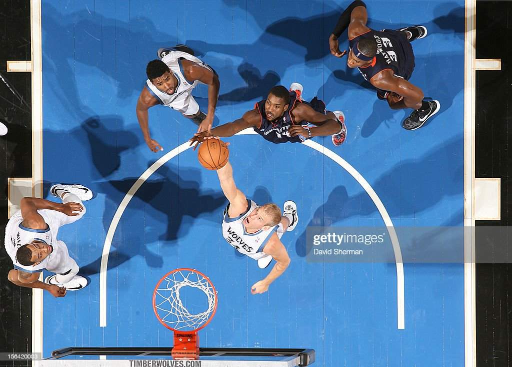 Greg Stiemsma of the Minnesota Timberwolves goes to the basket during the game between the Minnesota Timberwolves and the Charlotte Bobcats on...