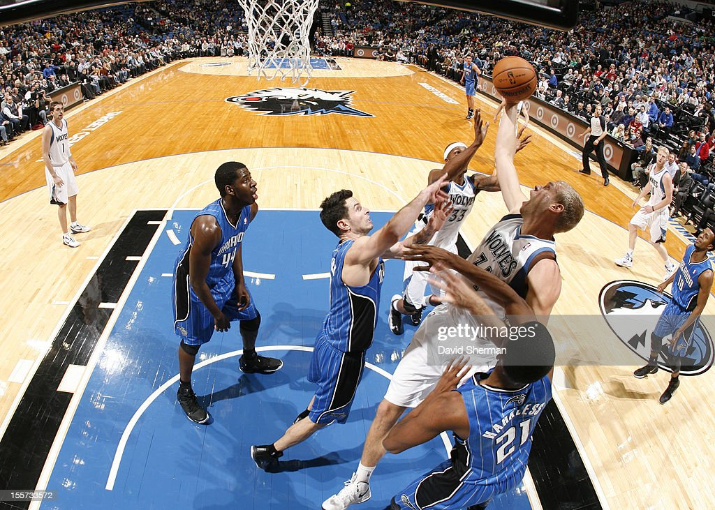 Greg Stiemsma #34 of the Minnesota Timberwolves goes to the basket under pressure during the game between the Minnesota Timberwolves and the Orlando Magic on November 7, 2012 at Target Center in Minneapolis, Minnesota.
