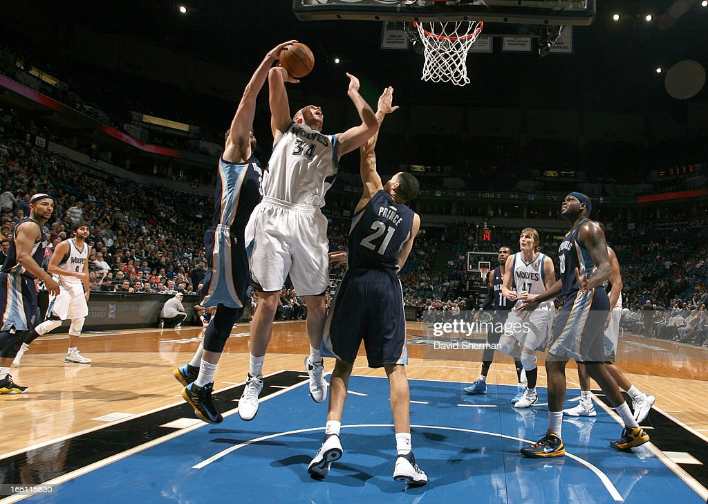 Greg Stiemsma #34 of the Minnesota Timberwolves goes to the basket under pressure during the game between the Memphis Grizzlies and the Minnesota Timberwolves on March 30, 2013 at Target Center in Minneapolis, Minnesota.