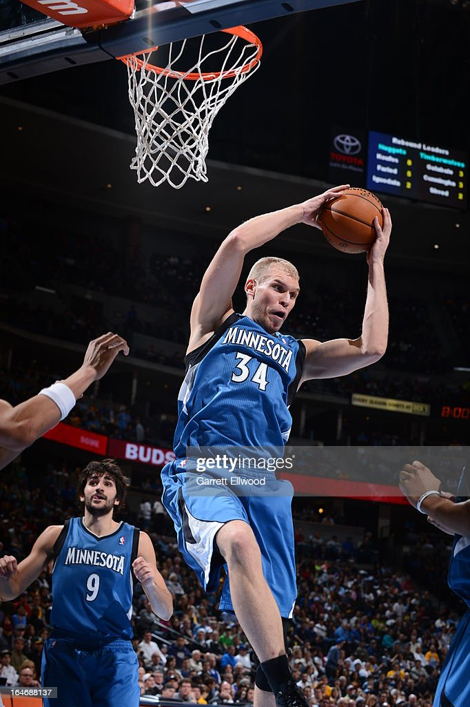 <a gi-track='captionPersonalityLinkClicked' href=/galleries/search?phrase=Greg+Stiemsma&family=editorial&specificpeople=2098297 ng-click='$event.stopPropagation()'>Greg Stiemsma</a> #34 of the Minnesota Timberwolves grabs a rebound against the Denver Nuggets on March 9, 2013 at the Pepsi Center in Denver, Colorado.