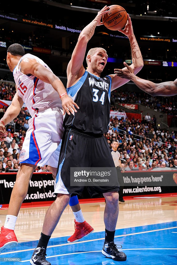 Greg Stiemsma of the Minnesota Timberwolves grabs a rebound against the Los Angeles Clippers at Staples Center on April 10 2013 in Los Angeles...