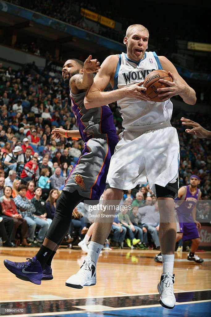 <a gi-track='captionPersonalityLinkClicked' href=/galleries/search?phrase=Greg+Stiemsma&family=editorial&specificpeople=2098297 ng-click='$event.stopPropagation()'>Greg Stiemsma</a> #34 of the Minnesota Timberwolves grabs the rebound against the Phoenix Suns during the game on April 13, 2013 at Target Center in Minneapolis, Minnesota.