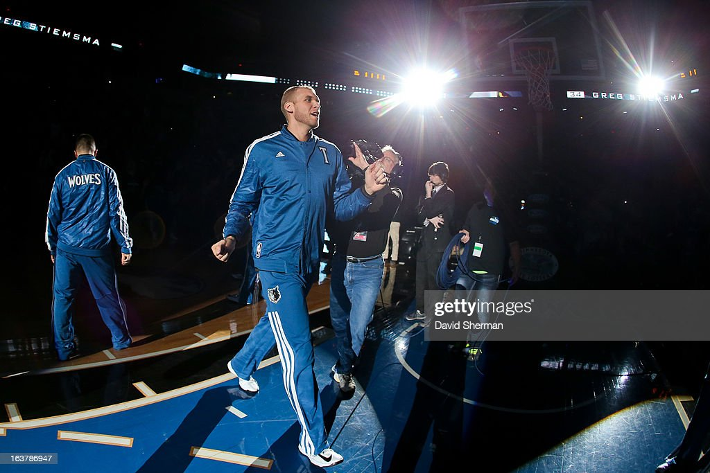 Greg Stiemsma of the Minnesota Timberwolves greets teammates before playing against the San Antonio Spurs on March 12 2013 at Target Center in...