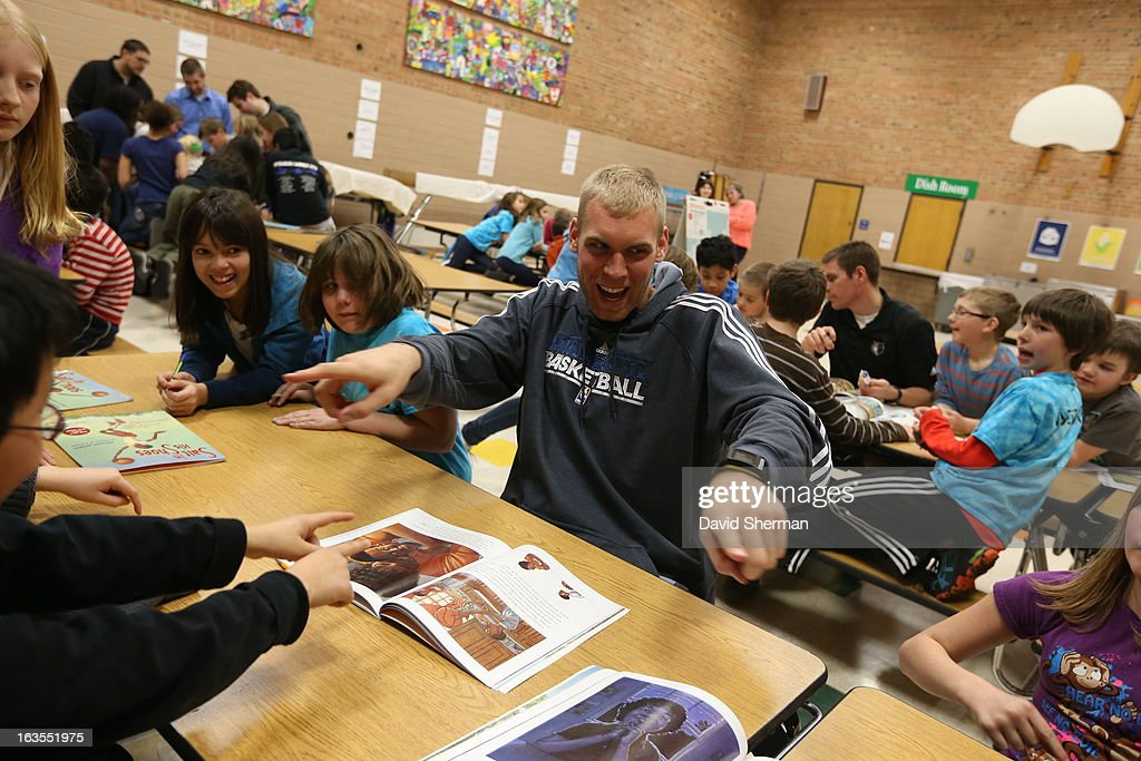 <a gi-track='captionPersonalityLinkClicked' href=/galleries/search?phrase=Greg+Stiemsma&family=editorial&specificpeople=2098297 ng-click='$event.stopPropagation()'>Greg Stiemsma</a> #34 of the Minnesota Timberwolves laughs with students during a Reading Timeout as part of the Minnesota Timberwolves FastBreak Foundation's Read to Achieve Month on March 11, 2013 at St. Anthony Park Elementary School in St. Paul, Minnesota.