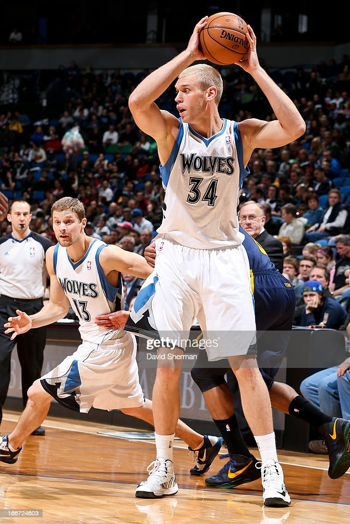 Greg Stiemsma of the Minnesota Timberwolves looks to pass the ball against the Utah Jazz on April 15 2013 at Target Center in Minneapolis Minnesota...