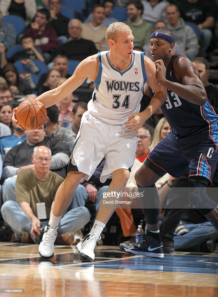 Greg Stiemsma of the Minnesota Timberwolves protects the ball from Brendan Haywood of the Charlotte Bobcats during the game between the Minnesota...