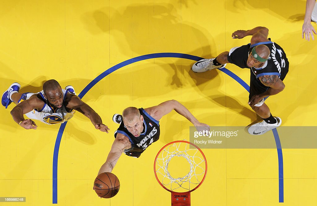 <a gi-track='captionPersonalityLinkClicked' href=/galleries/search?phrase=Greg+Stiemsma&family=editorial&specificpeople=2098297 ng-click='$event.stopPropagation()'>Greg Stiemsma</a> #34 of the Minnesota Timberwolves rebounds against <a gi-track='captionPersonalityLinkClicked' href=/galleries/search?phrase=Carl+Landry&family=editorial&specificpeople=4111952 ng-click='$event.stopPropagation()'>Carl Landry</a> #7 of the Golden State Warriors on April 9, 2013 at Oracle Arena in Oakland, California.