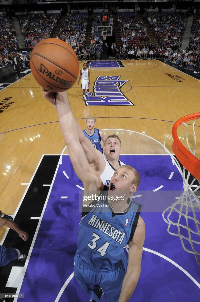 Greg Stiemsma #34 of the Minnesota Timberwolves rebounds the ball against Cole Aldrich #45 of the Sacramento Kings on March 21, 2013 at Sleep Train Arena in Sacramento, California.