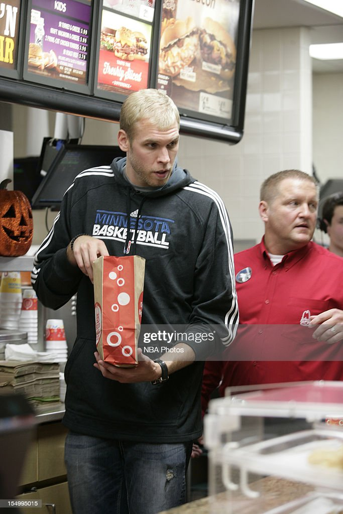 Greg Stiemsma of the Minnesota Timberwolves serve customers to raise money to benefit both the Arby's Foundation in support of Share our Strength's No Kid Hungry campaign and the Minnesota Timberwolves FastBreak Foundation on October 29, 2012 at the Arby's restaurant in St. Louis Park, Minnesota.