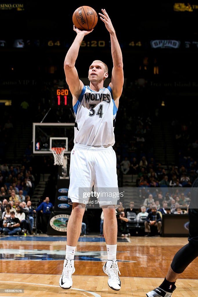 Greg Stiemsma of the Minnesota Timberwolves shoots against the San Antonio Spurs on March 12 2013 at Target Center in Minneapolis Minnesota NOTE TO...