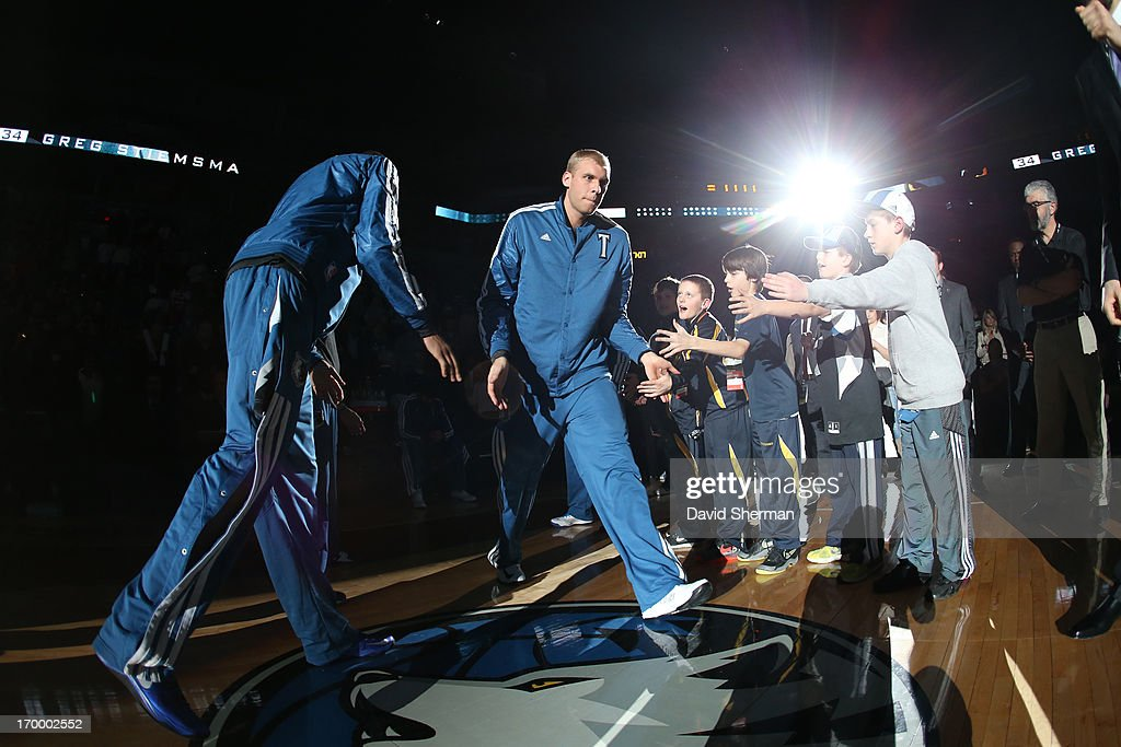 <a gi-track='captionPersonalityLinkClicked' href=/galleries/search?phrase=Greg+Stiemsma&family=editorial&specificpeople=2098297 ng-click='$event.stopPropagation()'>Greg Stiemsma</a> #34 of the Minnesota Timberwolves walks onto the court against the Washington Wizards during the game on March 6, 2013 at Target Center in Minneapolis, Minnesota.