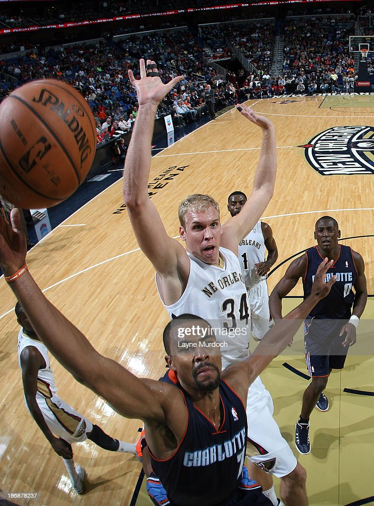 Greg Stiemsma of the New Orleans Pelicans attempts a block against Ramon Sessions of the Charlotte Bobcats during an NBA game on November 2 2013 at...