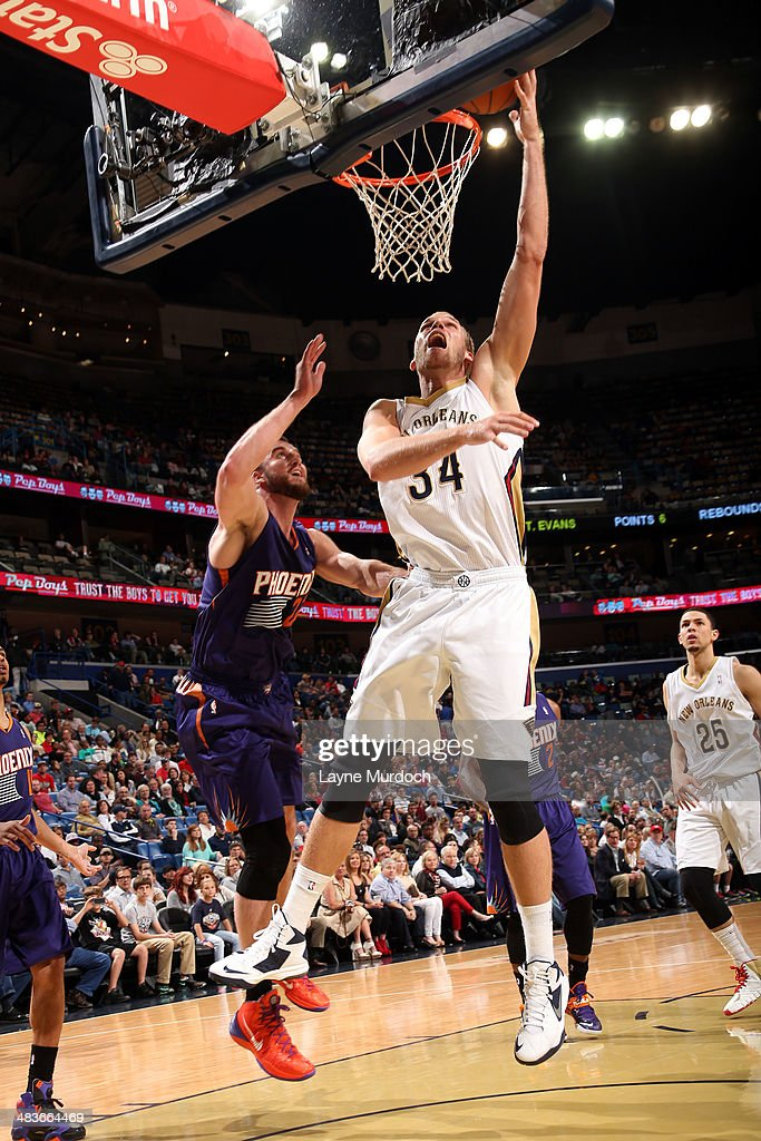 Greg Stiemsma of the New Orleans Pelicans goes up for a shot against the Phoenix Suns on April 9 2014 at the Smoothie King Center in New Orleans...