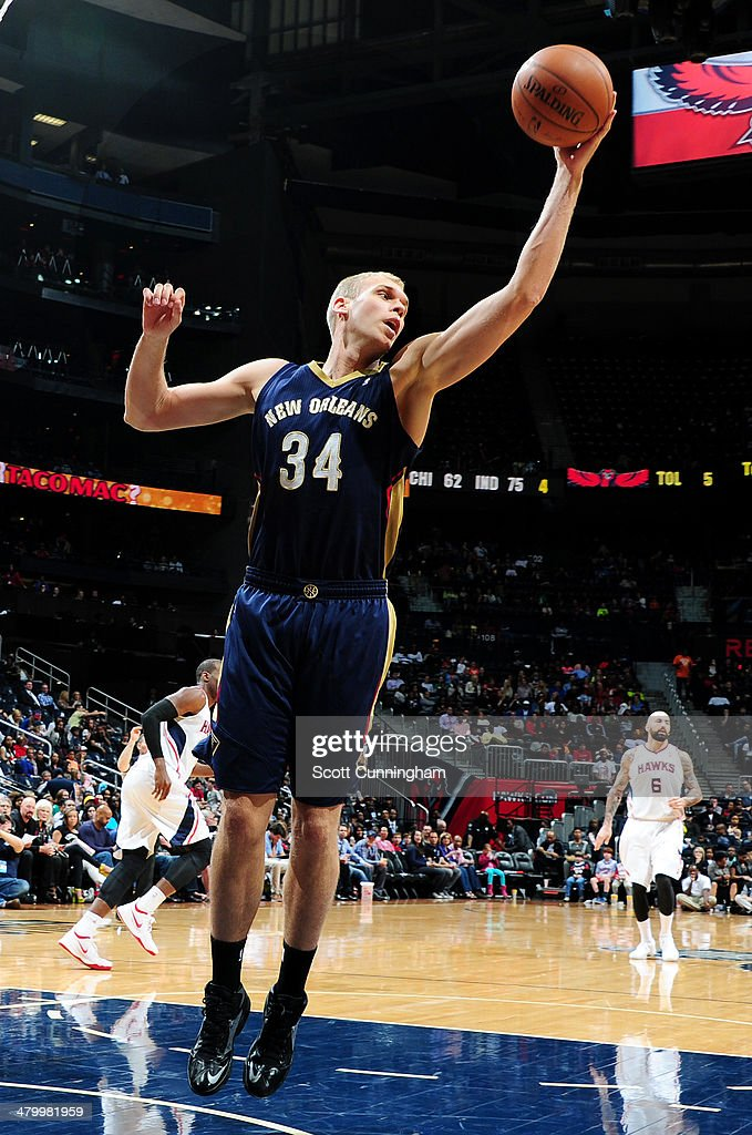 Greg Stiemsma of the New Orleans Pelicans grabs a rebound against the Atlanta Hawks on March 21 2014 at Philips Arena in Atlanta Georgia NOTE TO USER...