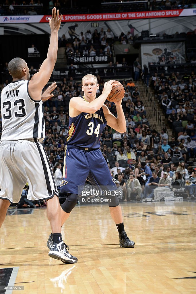 Greg Stiemsma of the New Orleans Pelicans handles the ball against Boris Diaw of the San Antonio Spurs at the ATT Center on March 29 2014 in San...