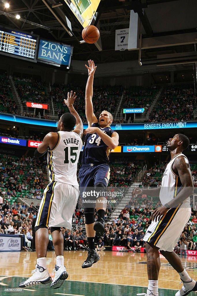 Greg Stiemsma #34 of the New Orleans Pelicans shoots against Derrick Favors #15 of the Utah Jazz at EnergySolutions Arena on April 04, 2014 in Salt Lake City, Utah.