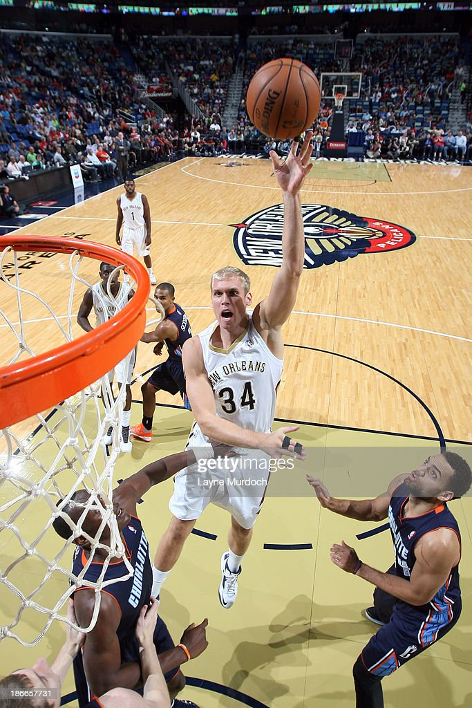Greg Stiemsma of the New Orleans Pelicans shoots against the Charlotte Bobcats on November 2 2013 at the New Orleans Arena in New Orleans Louisiana...
