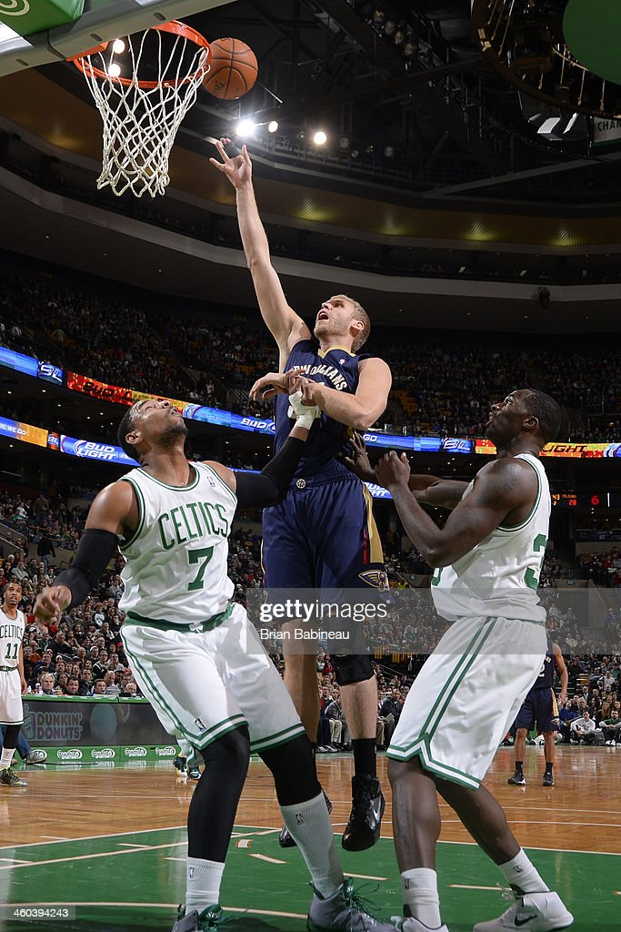 Greg Stiemsma of the New Orleans Pelicans shoots the ball against Jared Sullinger and Brandon Bass of the Boston Celtics on January 3 2014 at the TD...