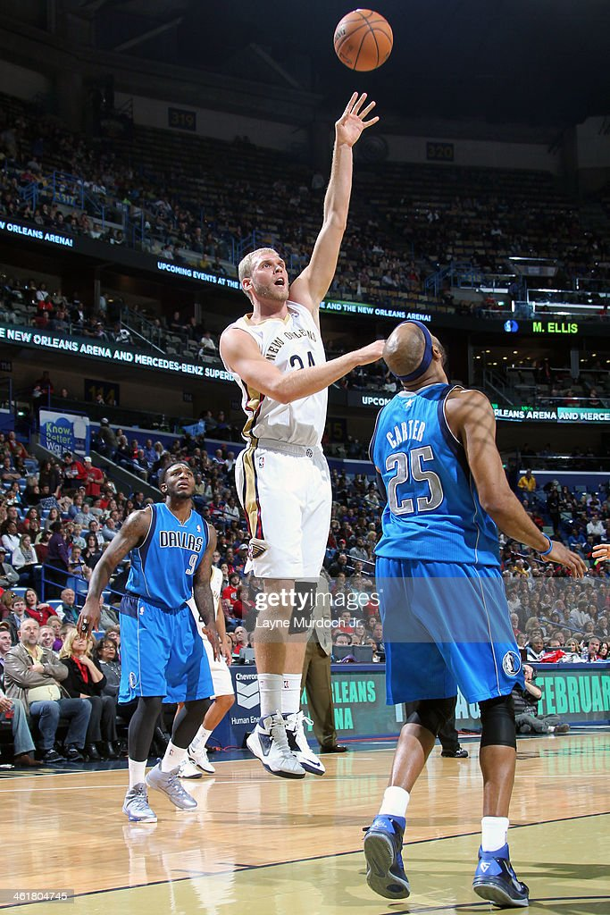 Greg Stiemsma of the New Orleans Pelicans shoots the ball against the Dallas Mavericks on January 10 2014 at the New Orleans Arena in New Orleans...