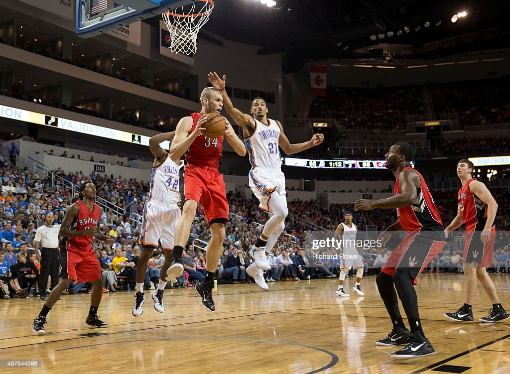 Greg Stiemsma of the Toronto Raptors grabs the rebound against Andre Roberson of the Oklahoma City Thunder on October 17 2014 at the Intrust Bank...