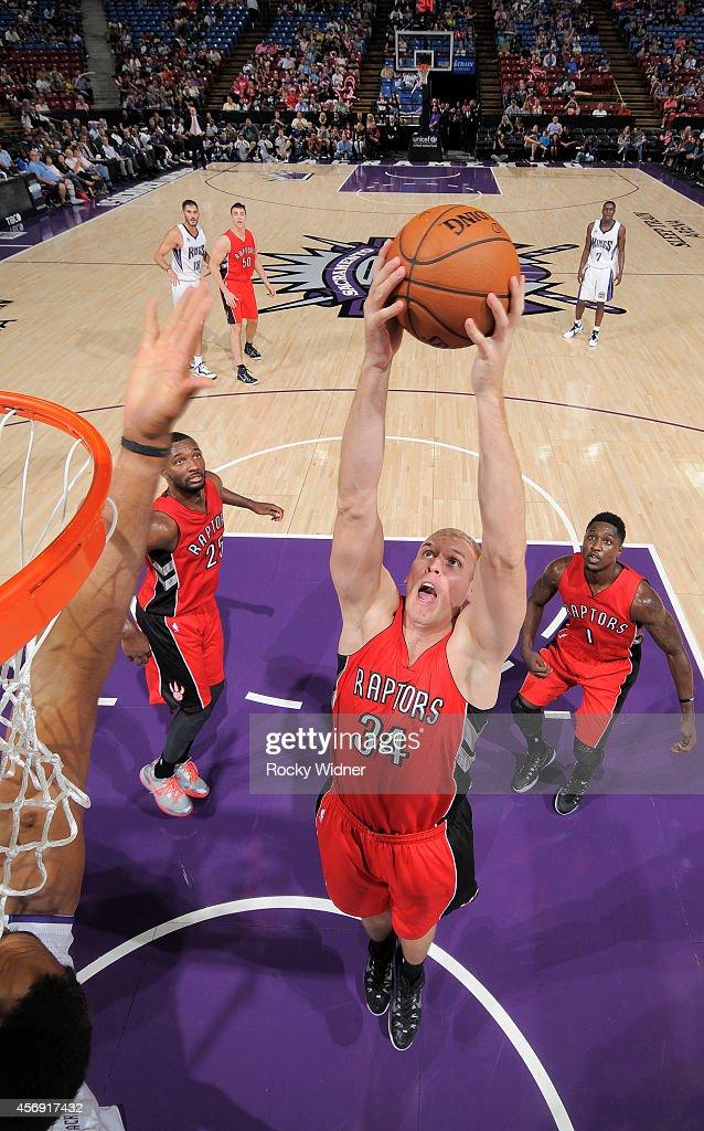 Greg Stiemsma of the Toronto Raptors rebounds against the Sacramento Kings on October 7 2014 at Sleep Train Arena in Sacramento California NOTE TO...