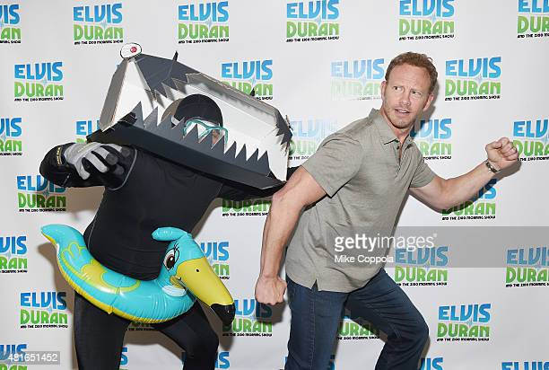 Greg T chases actor Ian Ziering as he visits 'The Elvis Duran Z100 Morning Show'at Z100 Studio on July 23 2015 in New York City