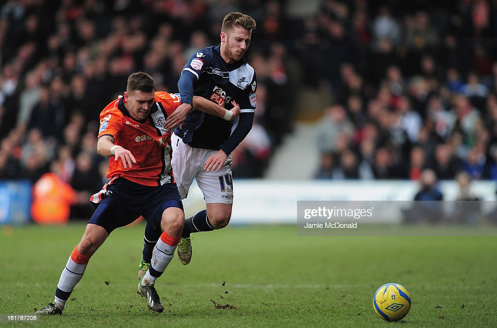 Greg Taylor of Luton Town battles with James Henry of Millwall during the FA Cup with Budweiser fifth round match between Luton Town and Millwall at Kenilworth Road on February 16, 2013 in Luton, England.