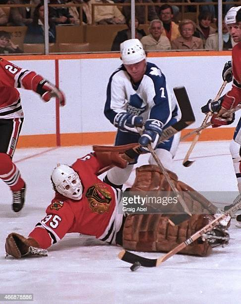Greg Terrion of the Toronto Maple Leafs reaches for the puck over Tony Esposito of the Chicago Black Hawks at Maple Leaf Gardens in Toronto Ontario...