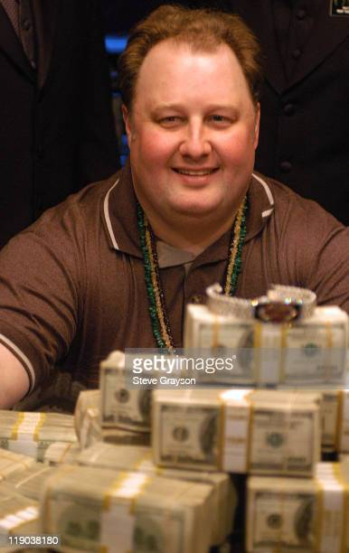 Greg ' The Fossilman' Raymer poses with the five million dollar first prize in the 2004 World Series of Poker at Binion's Horseshoe Club and Casino...