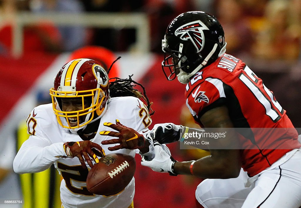 Greg Toler of the Washington Redskins nearly intercepts a touchdown pass intended for Mohamed Sanu of the Atlanta Falcons at Georgia Dome on August...