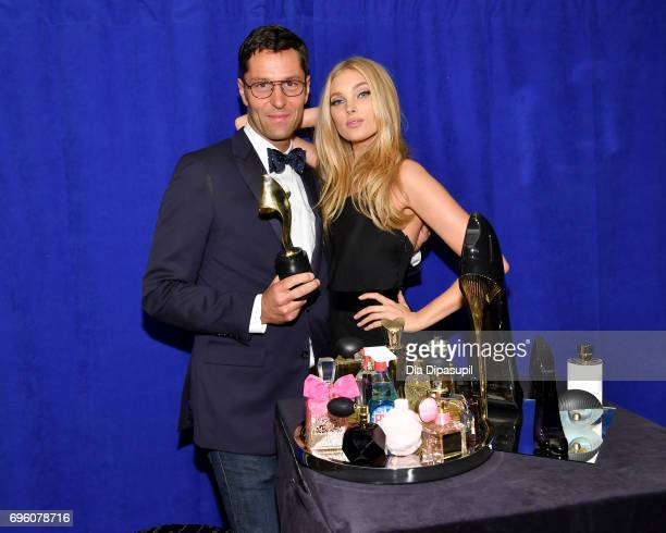 Greg Uris and Elsa Hosk pose backstage at the 2017 Fragrance Foundation Awards Presented By Hearst Magazines at Alice Tully Hall on June 14 2017 in...