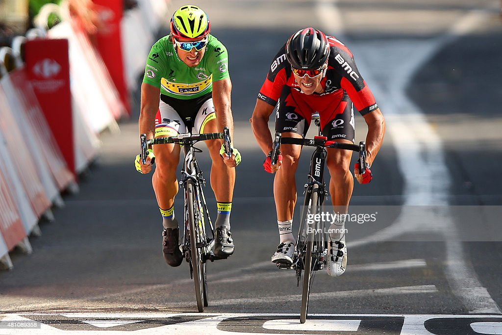 Greg van Avermaet of Belgium and BMC Racing Team crosses the finish line ahead of <a gi-track='captionPersonalityLinkClicked' href=/galleries/search?phrase=Peter+Sagan&family=editorial&specificpeople=4846179 ng-click='$event.stopPropagation()'>Peter Sagan</a> of Slovakia and Tinkoff-Saxo during stage thirteen of the 2015 Tour de France, a 198.5 km stage between Muret and Rodez, on July 17, 2015 in Rodez, France.