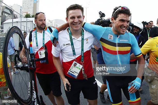 Greg van Avermaet of Belgium is congratulated from his team staffs after winning the gold medal in the Men's Road Race on Day 1 of the Rio 2016...