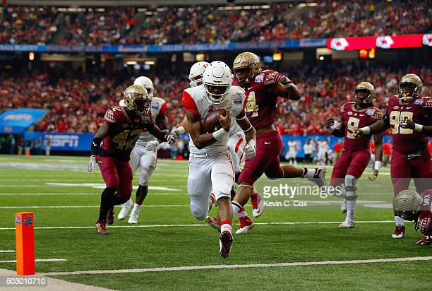 Greg Ward Jr #1 of the Houston Cougars runs 7yards to score a touchdown in the second quarter against the Florida State Seminoles during the...