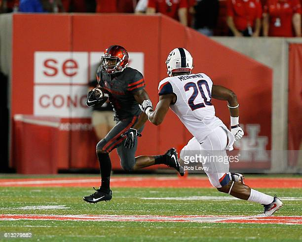 Greg Ward Jr #1 of the Houston Cougars runs with the ball as Obi Melifonwu of the Connecticut Huskies pursues on September 29 2016 in Houston Texas