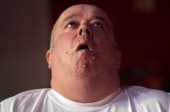 Greg West struggles after eating too many mince pies during the Wookey Hole Big Eat competition on November 22 2011 in Wells England The competition...